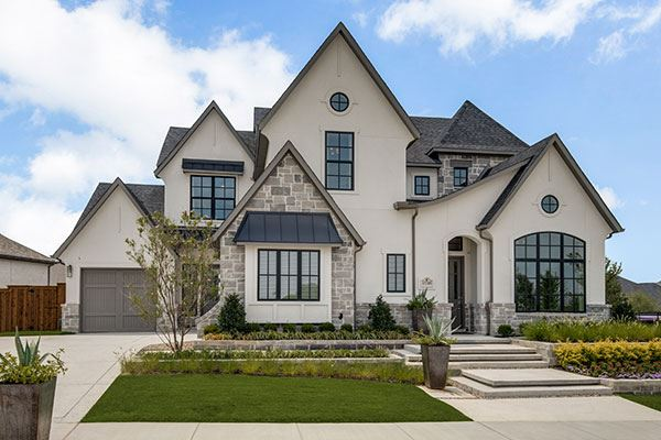 Model Home Exterior by Southgate Homes at 15309 Virburnum Drive in The Grove Frisco