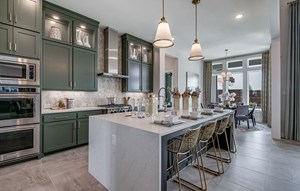 Model home kitchen and dining room - Southgate Homes at The Grove Frisco