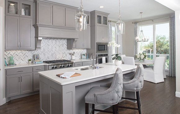 Plan 1620 model home kitchen - American Legend Homes at The Grove Frisco