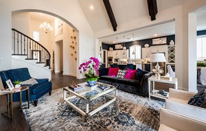 Model home living room - Highland Homes at The Grove Frisco