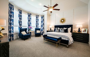 Model home master bedroom - Highland Homes at The Grove Frisco