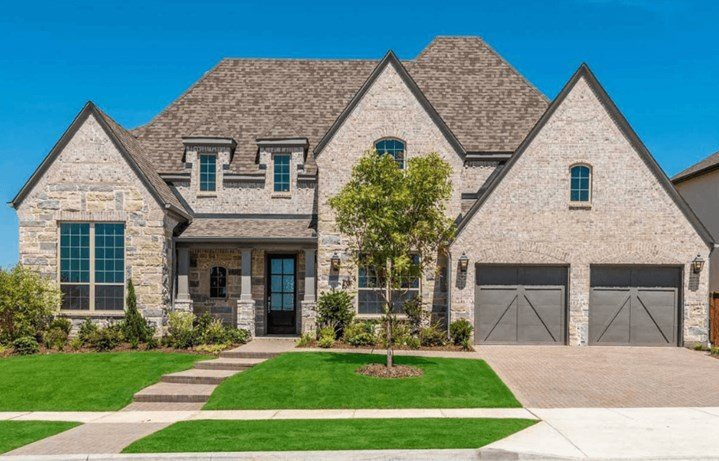 Highland Homes Plan 267 Elevation in The Grove Frisco