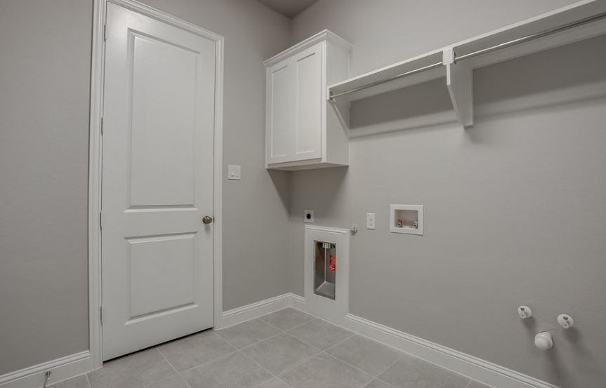 American-Legend-Homes-The-Grove-Frisco-Plan-631-Laundry-Room.jpg