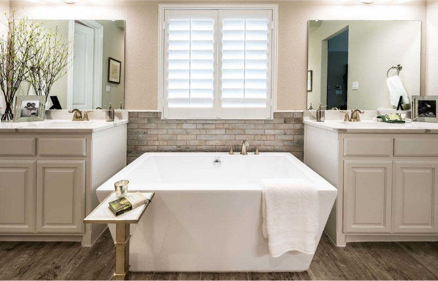 Highland Homes Plan 272 Owner's Bath in The Grove Frisco